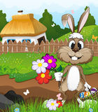 Easter bunny near a farmhouse Royalty Free Stock Photo