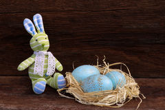 Easter Bunny Nest Duck Eggs on Rough Background Royalty Free Stock Photo