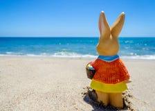 Easter bunny on the ocean beach Royalty Free Stock Photo