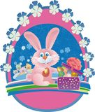 Easter bunny opens a gift Royalty Free Stock Image