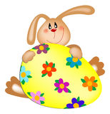 Easter bunny with a painted egg Stock Image