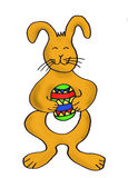 Easter bunny with painted egg Stock Photography