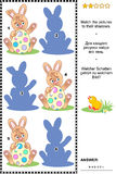 Easter bunny with painted egg shadow game Royalty Free Stock Image