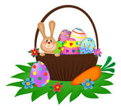 Easter bunny with a painted eggs in the basket Royalty Free Stock Photography