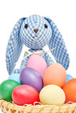 Easter Bunny and painted Eggs in basket on white. Easter Bunny Handmade and colorful painted Eggs in basket on white background Stock Photo