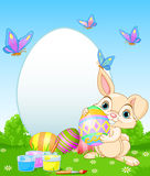 Easter Bunny painting Easter Eggs Royalty Free Stock Photography