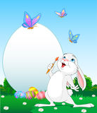 Easter Bunny painting Easter Eggs. Illustration of an Easter Bunny painting Easter Eggs. Perfect for your Easter Greeting Royalty Free Stock Photo