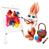 Easter bunny painting with  egg bucket Royalty Free Stock Photo