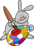 Easter bunny painting egg cartoon Stock Image