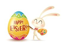 Easter bunny painting an egg. Royalty Free Stock Photos