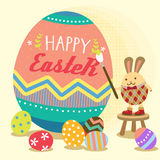 Easter bunny painting egg Royalty Free Stock Images