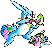 Easter bunny painting eggs. Blue bunny painting easter eggs Stock Photos