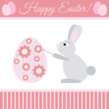 Easter Bunny Paints Egg. Cute cartoon bunny paints egg. Card to Easter Royalty Free Stock Photos