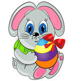 Easter bunny with paited egg. Royalty Free Stock Photography