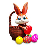 Easter bunny pick up egg Stock Photography
