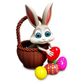 Easter bunny  pick up egg Royalty Free Stock Images