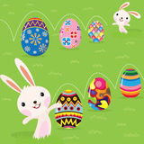 Easter bunny playful with painted eggs. A Vector Illustration of Easter bunny playful with painted eggs royalty free illustration