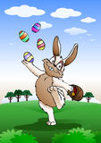 Easter bunny playing with egg Royalty Free Stock Image