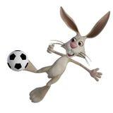 Easter bunny playing football Stock Photo