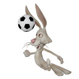 Easter bunny playing football Royalty Free Stock Photography