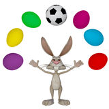 Easter bunny playing football Royalty Free Stock Photo