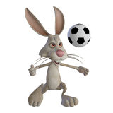 Easter bunny playing football Royalty Free Stock Images