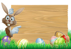 Easter bunny pointing at sign Royalty Free Stock Photos