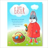 Easter bunny poster with basket-02. Festive poster for Easter. Easter bunny in a red cloak with a basket of painted eggs and tulips. Easter cake with a burning Royalty Free Stock Photo