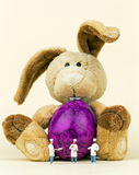 Easter bunny. Protects egg before miniature Chefs Royalty Free Stock Photography