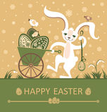 Easter bunny with pushcart. Royalty Free Stock Photography