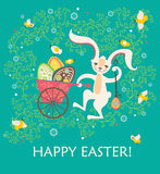 Easter bunny with pushcart eggs. Royalty Free Stock Photos