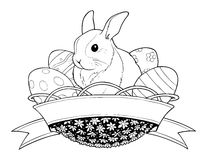 Easter bunny rabbit in basket with eggs Stock Photography