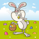 Easter bunny rabbit delivering Easter eggs Stock Photo