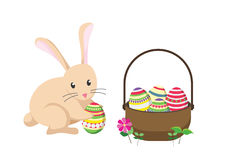 Easter bunny rabbit with Easter basket full of decorated Easter eggs. Royalty Free Stock Image