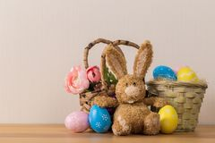 Easter bunny rabbit with painted egg on wooden background royalty free stock image