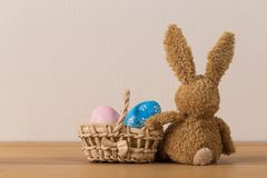 Easter bunny rabbit with painted egg on wooden background royalty free stock images