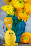 Easter bunny and ranunculus Stock Photography