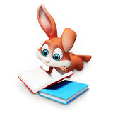 Easter bunny reading a books Stock Photos