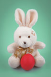 Easter bunny with the red egg Stock Image