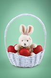 Easter bunny with red eggs Stock Images