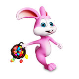 Easter bunny running with eggs bucket Royalty Free Stock Image