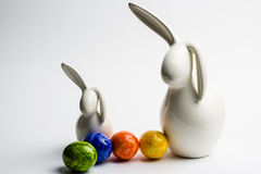 Easter bunny's. With colored eggs Royalty Free Stock Images