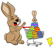 Easter bunny with shopping cart Stock Photo