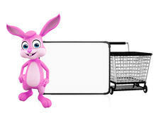 Easter Bunny with signboard and trolley Royalty Free Stock Photo