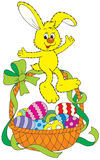 Easter bunny sitting on a basket. Vector clip-art / Easter character for your design, scrapbook and holiday card Stock Photo