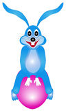 Easter bunny sitting on an egg Royalty Free Stock Photo