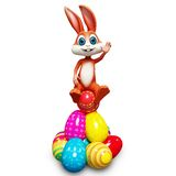 Easter bunny sitting on pile of egg Royalty Free Stock Photography