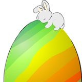 Easter bunny sleeping on an egg Royalty Free Stock Images