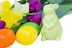 Easter bunny with spring flowers and eggs Stock Images