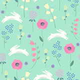 Easter bunny with spring flowers seamless pattern on green background.